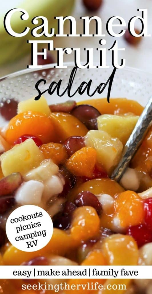 Pinerest pin image of colorful canned fruit salad recipe in a bowl with peaches, grapes, pineapple, cherries, banana, and marshmallows.