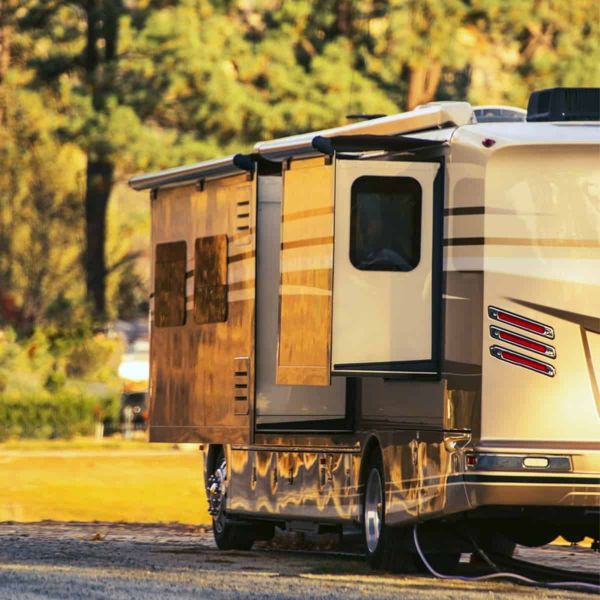Feature image of a class A motorhome with utilities hooked up.